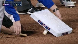 ATL@NYM: Loose second base causes delay in ballgame