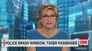 Police smash window, taser man