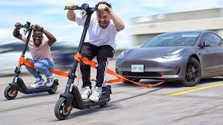 Using An Electric Scooter To TOW MY TESLA!! (NIU KQi3)