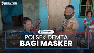 Ajak Warga Disiplin Terapkan Protokol Kesehatan, Polsek Demta Bagikan Masker Gratis