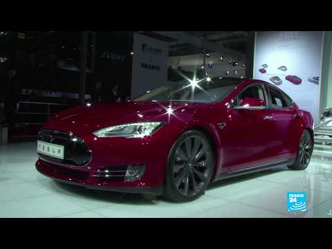 Tesla defies Wall Street expectations and turns profit