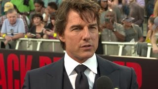 Tom Cruise Discusses His Trademark Run at 'Jack Reacher: Never Go Back' Premiere