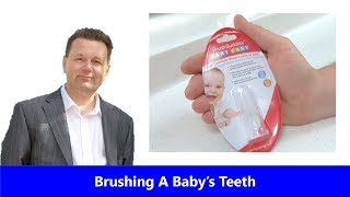 Brushing Baby's Teeth - How to use baby's first toothbrush