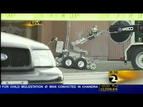 Robot Cops Aren't Supposed To Drop Grenades And Run Over Them