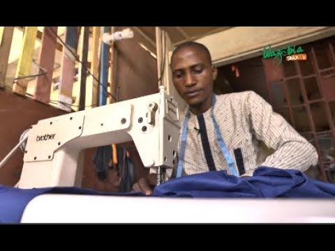 """BY THE GRACE OF GOD I WILL FINISH YOUR CLOTH""  TAILOR IBRAHIM"