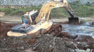 Will he ever get this excavator out?
