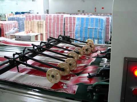 Automatic Roll Fed, Flat Bed Die Cutting Machine