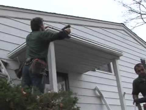 The video describes the benefits of the LeafGuard patented gutter systems. Gutter hoods, covers, and helmets do not fix the problem of clogged gutters, and they ruin your roof!