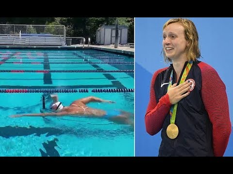 Five-time Olympic champion Katie Ledecky swims the length of a pool with CHOCOLATE MILK on her head