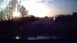 preview picture of video 'Red Audi TT - Overtaking off a roundabout into the sun.'