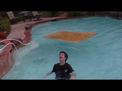 Scenario: Eric Michael Grimm (kid in maroon) attempts a 360 jump onto a wood board to slide across the pool. As he hits the tanning ledge he slips and falls. After the slip he slams his FACE into the wood board. FAIL!
