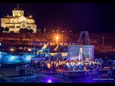 For an operatic example, this is one of my favorite opera arias sung in open air with a wonderful staging and orchestra.