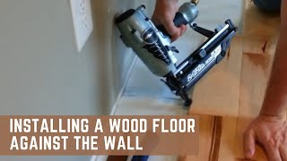 Installing a wood floor against the wall