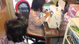 Agnès sewing a lavender bag