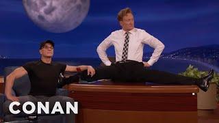Download Youtube: Jean-Claude Van Damme Helps Conan Limber Up  - CONAN on TBS