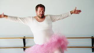 Overweight Man Wearing Ballerina Costume Practicing In Ballet Studio