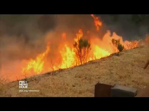 News Wrap: Firefighters race to protect neighborhoods from massive Thomas fire