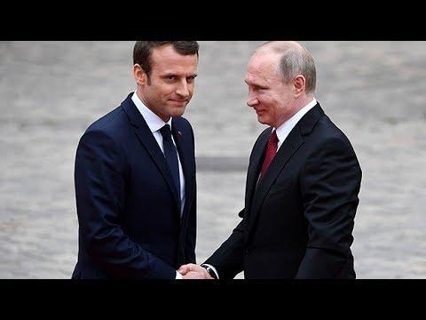Macron and Putin share perfunctory handshake