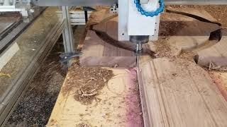 "CNC router cutting 2"" thick black walnut wood"