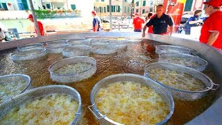 Tons of Fish and Seafood Fried in a Huge Pan. Italy Street Food Festival, Never Seen Before