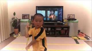 my son acting Bruce Lee's Game Of Death  Nunchaku
