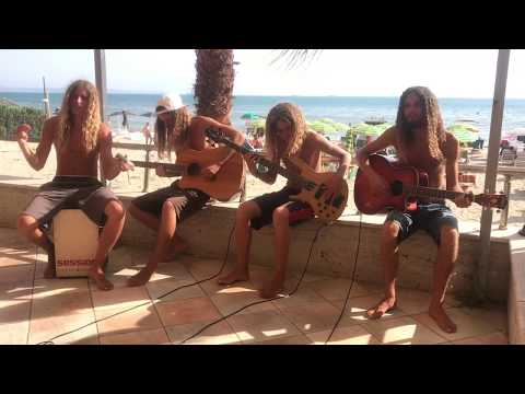 "Four dudes on a beach sing ""No Rain"" by Blind Melon"