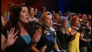 Amazing choir Perpetuum Jazzile performs Toto's Africa and uses there hands to simulate storm