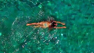 Drönare - En kvinna i poolen med mera