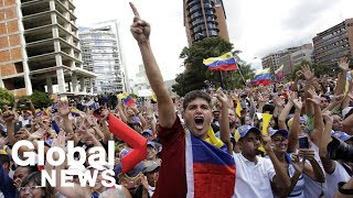 Supporters rally for president as anti-Maduro protests held in Venezuela