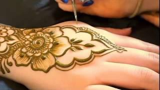 Simple And Modern Flower Henna Design On Hand