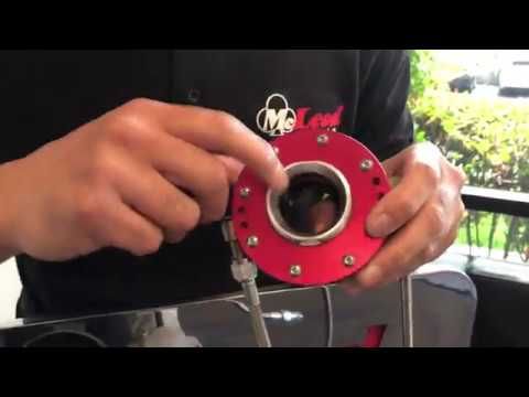 How Does a McLeod Throw Out Bearing Stay in Place?