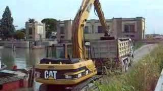 Cat 320B Loading Trucks In A Dredging Project - Italy 2007