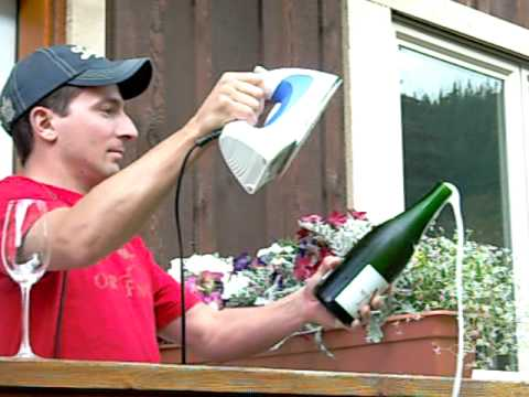 Who Knew Opening Champagne With A Glass Looked So Suave?