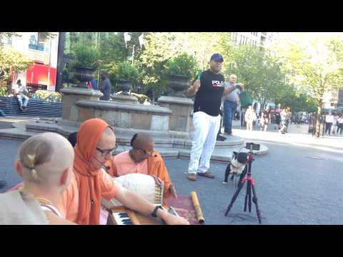 Natabara Gauranga Prabhu Chants Hare Krishna at Union Square and a Man with a Dog Plays Shakers