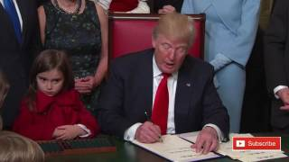 Donald Trump signing documents at Capitol Hill procedural grab-bag on Inauguration Day 2017 ✔