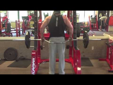 Cambered Barbell Seated Shrug