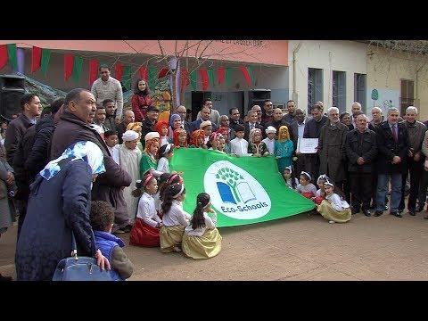 العرب اليوم - شاهد: مراسم تسليم اللواء الأخضر لمؤسسات تعليمية بعين تاوجدات