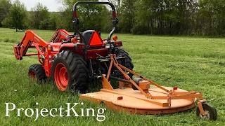 Kubota Tractor Cutting Grass and Weed with Bush Hog