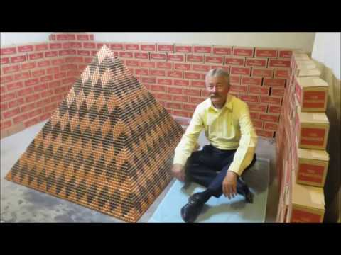 Extremely dedicated Arizona man uses over a million pennies to break the world record for largest penny pyramid.