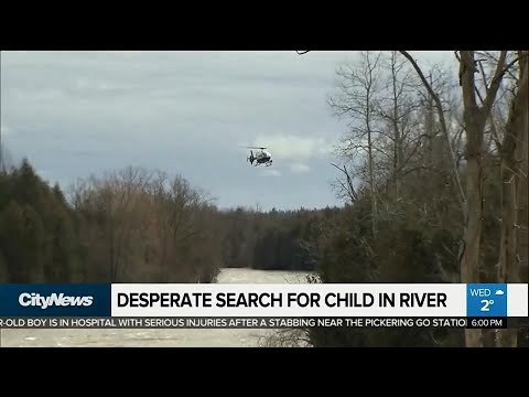 Desperate search for child swept away by Grand River