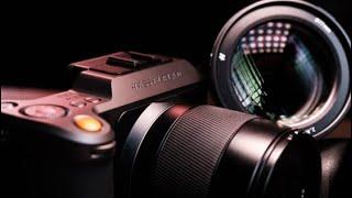 Should I buy a new camera or lens?