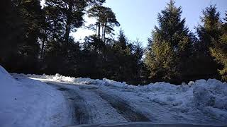 preview picture of video 'Ice road, snowfalls on the way to chelela pass, Paro, Bhutan by Abhisek Jana'