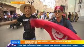 Болельщики на арене в Москве, затаив дыхание, ждут начало матча Россия - Уругвай