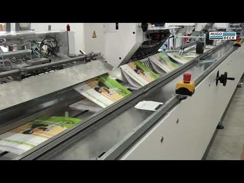 Broschüren mit eingeklebter CD versandfertig in Schrumpffolie