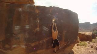 Darren Hauk Bouldering in Big Bend Bouldering Area outside of Moab, Utah
