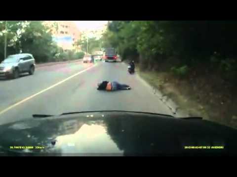 Woman falls asleep riding scooter