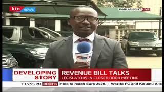 MPs and Senators in a closed-door meeting to discuss revenue bill