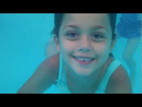 Cute young girls swimming