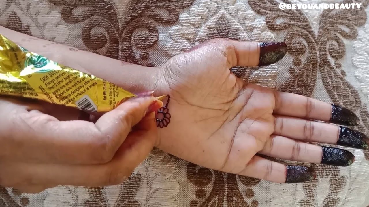 color mehndi design black and red shaded floral by be you and beauty