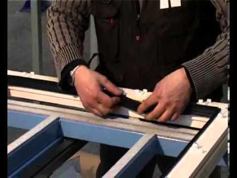 Montaje juntas de goma y clips sobre los marcos